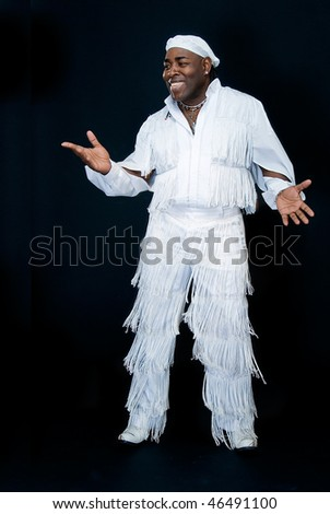 sympathetic black cuban man on black background - stock photo