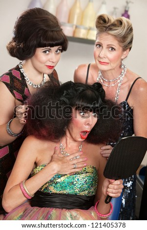 Sympathetic friends and upset woman in beauty salon - stock photo