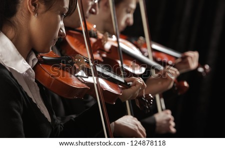 Symphony music, violinists at concert - stock photo