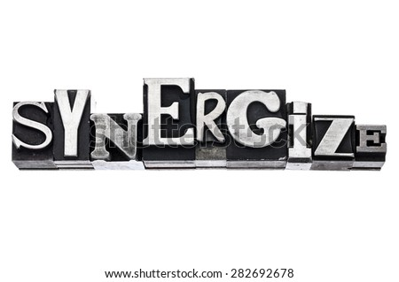 synergize - isolated word in vintage letterpress metal type blocks, variety of fonts - stock photo