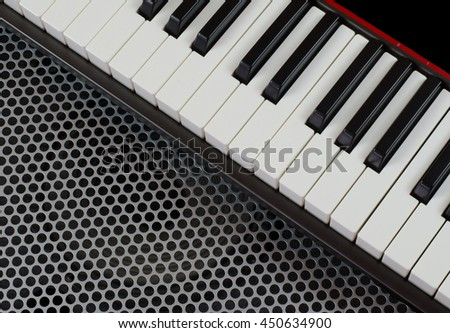 Synthesizer keyboard music instrument, studio shot at interesting perspective on Metal surface