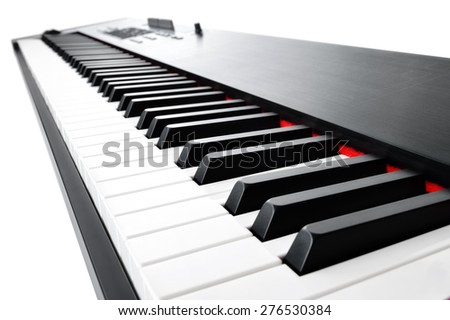 Synthesizer keyboard music instrument, studio shot at interesting perspective on white background