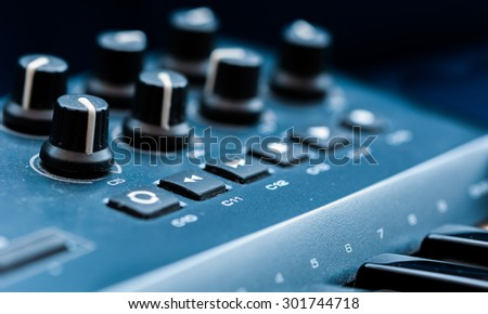 Synthesizer patch panel Close-up button knob on touch panel - stock photo