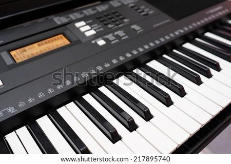 synthesizer under the white background - stock photo