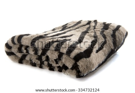 synthetic blanket in front of white background - stock photo