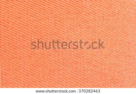 Synthetic fabrics orange texture for background