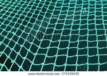 Synthetic fishing net macro - stock photo