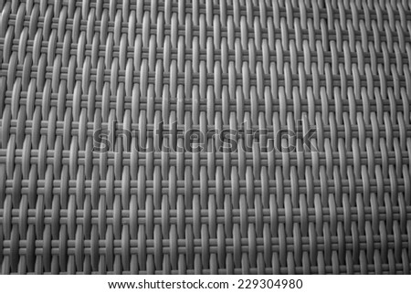 Synthetic rattan texture weaving background as used on outdoor garden furniture. - stock photo