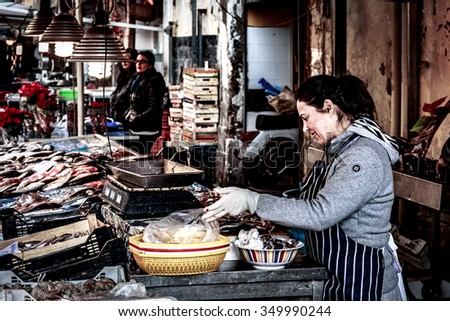 SYRACUSE, SICILY/ITALY - DECEMBER 08 2015: People and Travel Photography from the sicilian coastal town of Syracuse in Italy, Europe. High Contrast Grunge Look with additional Noise