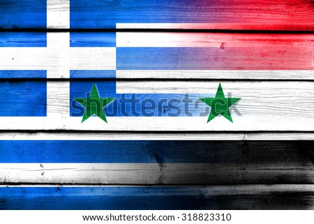 Syria and Greece Flag on wood background - stock photo