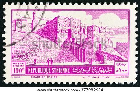 SYRIA - CIRCA 1952: A stamp printed in Syria shows Citadel, Aleppo, circa 1952.  - stock photo