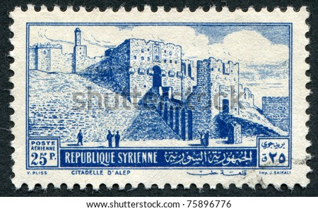 SYRIA-CIRCA 1952: A stamp printed in the Syria, shows The Citadel of Aleppo, circa 1952
