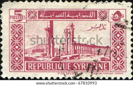 SYRIA - CIRCA 1940s: A stamp printed in Syria shows Palmyra - Tudmor, circa 1940s - stock photo