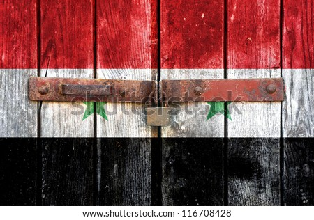 Syria flag on the background of old locked doors - stock photo
