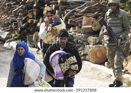 Syrian refugees are fleeing due to shelling in Latakia port city of Syria. Latakia, Syria, 15 February 2016. - stock photo