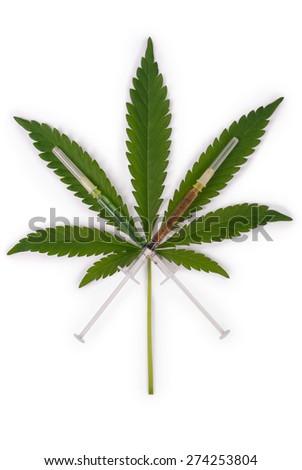 Syringe and hemp (cannabis) isolated on white background - stock photo