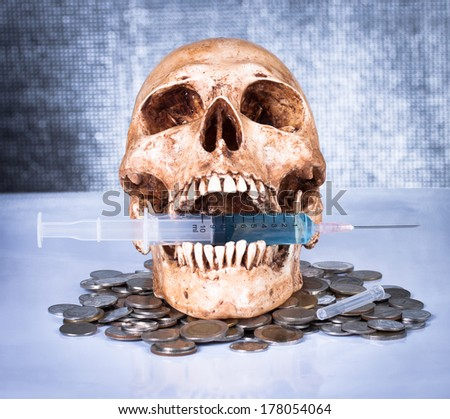 Syringe and human skull ,concept and idea - stock photo