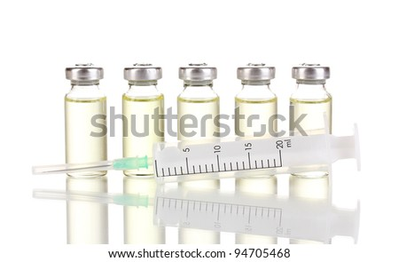 Syringe and medical ampoules isolated on white