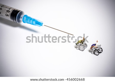 Syringe and seniors - stock photo