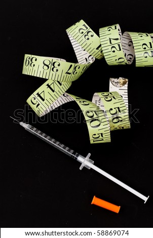 Syringe and Tape Measure ( Weight Loss )