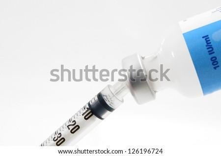Syringe and vials - stock photo