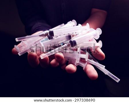 Syringe, closeup. Drug addiction concept. - stock photo