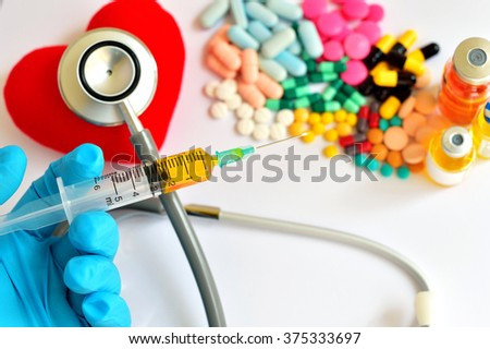 Syringe, heart, drugs and stethoscope, Heart disease concept