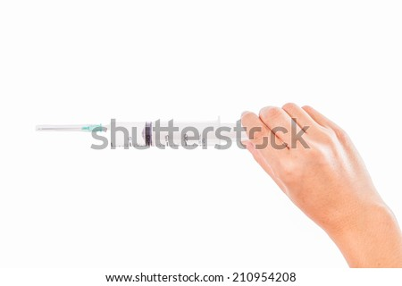 syringe in a hand of a young woman