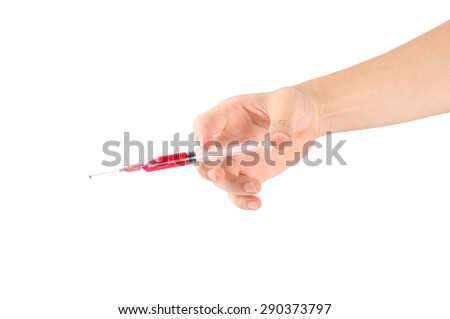 Syringe in a hand on white.