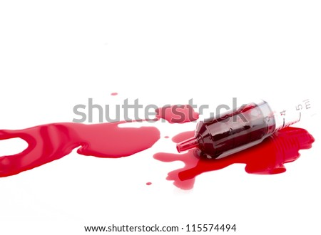 Syringe with blood - stock photo