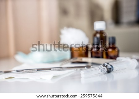 Syringe with glass vials and medications pills - stock photo