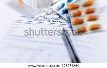 Syringe with glass vials and medications pills drug background - stock photo