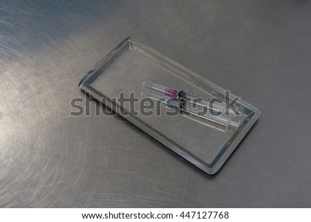 Syringe with needle on a steel tray for a medical vaccine in a hospital