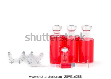 syringe with vial of medication closeup - stock photo