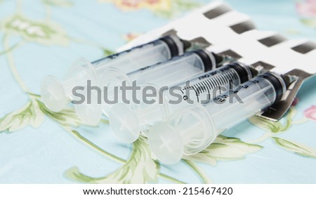 Syringes ready to use in a hospital room. - stock photo
