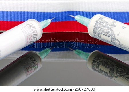 Syringes with dollars and roubles pierce the ribbon of the Russian flag - stock photo