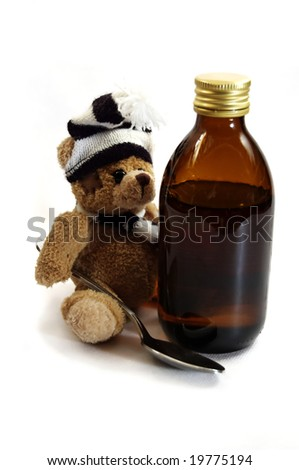 Syrup and spoon for children - stock photo
