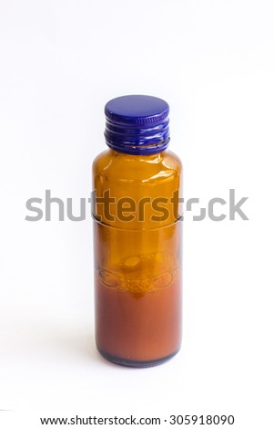 syrup bottle on white background - stock photo