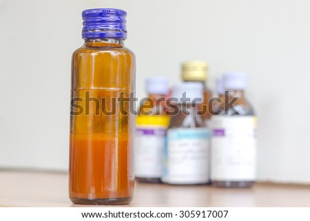 syrup bottle with syrup bottles background