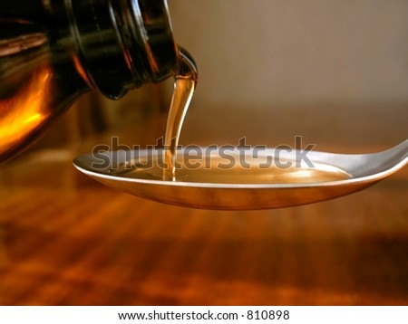 syrup in spoon - stock photo