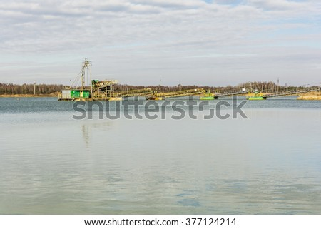 System for the extraction of gravel in the gravel pit water.  - stock photo