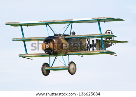 SYWELL AERODROME, NORTHAMPTONSHIRE, UK - AUGUST 18: Fokker Triplane replica of the Great War Display Team (GWDT) on August 18, 2012 at the Sywell Fly-in at Sywell Aerodrome, Northamptonshire, UK.