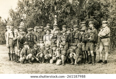 SZCZAWNICA, POLAND, CIRCA 1950's: Vintage photo of group of scouts and their tutors outdoor - stock photo