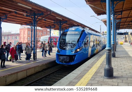 SZCZECIN, POLAND - APRIL 9, 2015: The arrival of suburban trains at Szczecin main station. The station opened on 15 August 1843