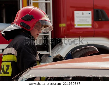 SZCZECIN, POLAND - JULY 08, 2014: Fire and Rescue Emergency Units at car accident with Power Wedge.