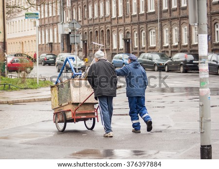 Szczecin, Poland - March 25, 2014: An unidentified man transports discarded materials