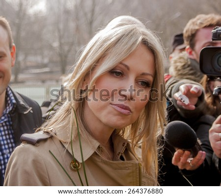 SZCZECIN, POLAND - MARCH 25, 2015: Magdalena Ogorek, candidate for President of the Republic Poland, attend a campaign rally. Ogorek is former bit-part actress and TV presenter.  - stock photo