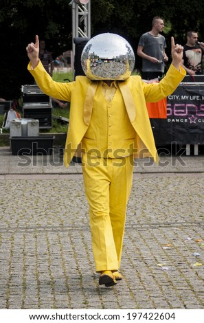 SZCZECIN, POLAND - MAY 23, 2014: Juwenalia, is an annual students' holiday in Poland, usually celebrated for three days in late May. Disco Ball Man in a yellow dress, dancing in the street. - stock photo