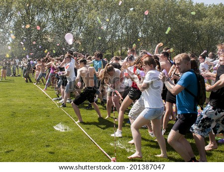 SZCZECIN, POLAND - MAY 23, 2014: Juwenalia, is an annual students' holiday in Poland, usually celebrated for three days in late May.Some 500 participants joined the massive epic water balloon battle.