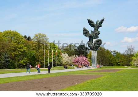 SZCZECIN, POLAND - MAY 03, 2015: Monument of the Poles deed in the form of Three Eagles at a park with people - stock photo